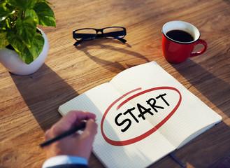 "Businessman Writing the Word ""Start"""