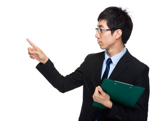 Businessman with clipboard and finger point aside