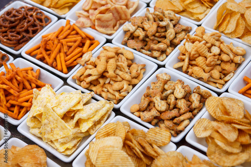 Many types of savoury snack in white dishes - 66691768