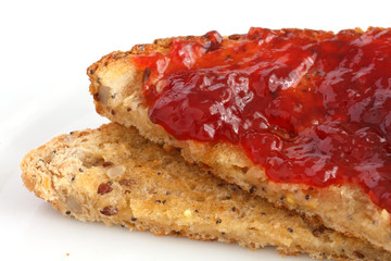 Multi-seed wholegrain bread toasted and buttered with jam