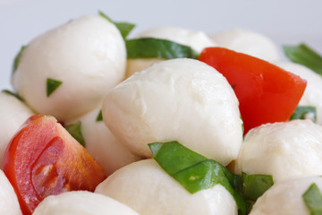 Tomato and mozzarella salad on a plate.