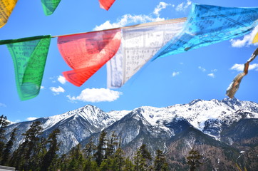 Tibetan Prayer Flags on Snow Mountains