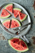 Watermelon pieces sliced in triangle on a tray