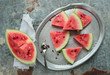 Watermelon sliced in pieces on a metal tray