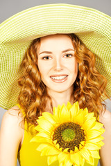 red-haired girl with sunflower.
