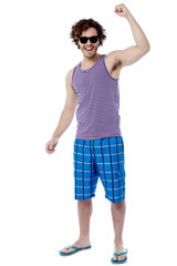 Excited young man raising his arm