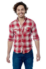 Smiling young casual man posing