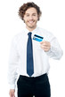 Happy man displaying his cash card