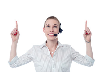 Young call center woman pointing up