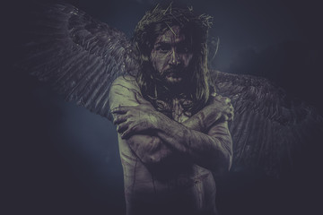 representation of jesus with wings and crown of thorns