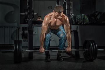 Male bodybuilder raises the bar.
