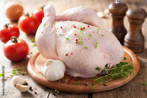 whole raw chicken with rose pepper and thyme - 66694789