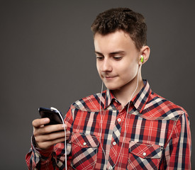 Teen listening music from smartphone