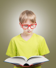Preteen boy reading a book