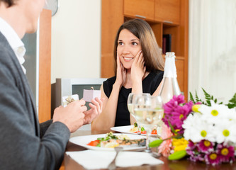 Man giving to girl the jewel box  at home