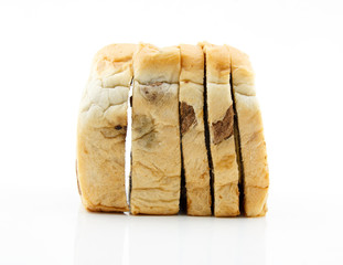 Sliced raisin bread on white background