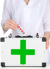 Nurse holding first aid kit, close up