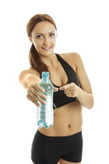 Fit woman pointing to water bottle. Hydration is the secret