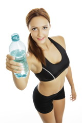 Smiling fit woman holding plastic water bottle isolated on white