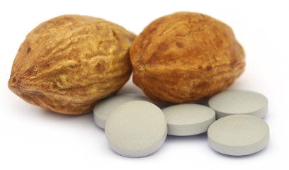 Medicinal Haritaki fruits with tablets