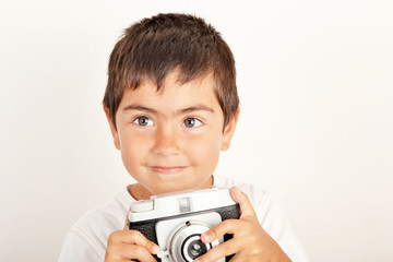 Little boy with old photo camera