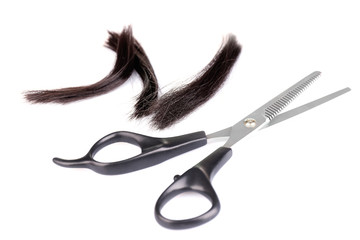 Cut hair and scissors, isolated on white