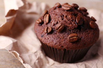 Chocolate muffin and coffee grains