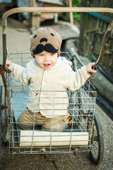 toddler boy riding in the cart