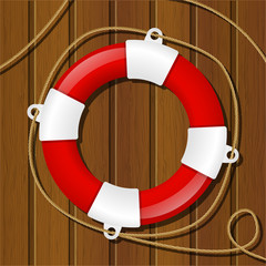 Red lifebuoy on wooden background