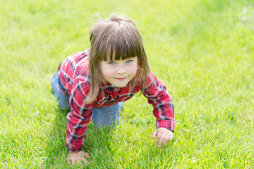 little girl on the grass