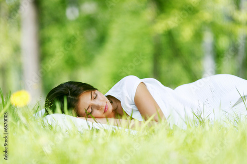 Leinwanddruck Bild Woman sleeping on grass