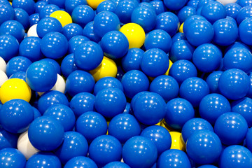 plastic blue, yellow and white balls