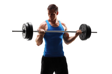 Muscular young man exercising with a barbell