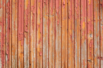 old grey planks with fading orange and red paint