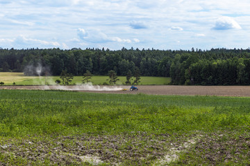 tractor plowing a field on a sunny day