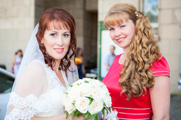 Happy smiling bride with bridesmaid