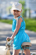 Pretty girl looking back from shoulders when riding bicycle