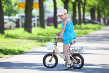 Caucasian girl riding a bicycle in park