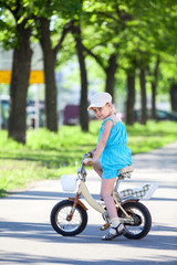 Full lenght of pretty girl in bicycle