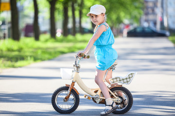 Pretty girl riding bicycle in park