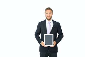 Young businessman holding digital tablet on white background