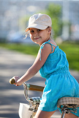 Pretty girl riding bicycle, close-up
