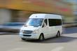 Leinwanddruck Bild - minibus goes on the city street
