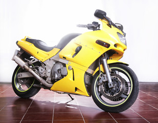 yellow motorcycle in studio