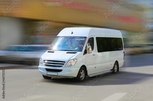 Leinwanddruck Bild minibus goes on the city street