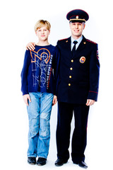 boy stands next to the police