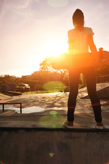 skateboarding woman sunrise skatepark