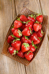 Ripe sweet strawberries on plate on table close-up