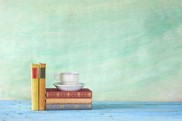 vintage books with coffee cup, grungy background, free copy spac