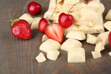 White broken chocolate bar and fresh berries,